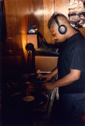DJ Screw on the mixer and turntables